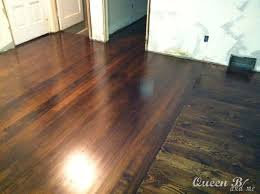 start with 60grit and sand the whole floor then move to 80 grit