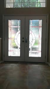 decorative front doors with glass and iron inserts for exterior panels