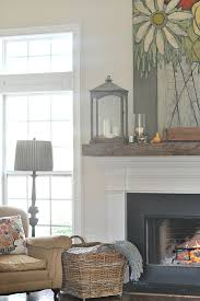 love the idea of adding a chunky reclaimed wood mantle to top the skinnier