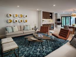 Installing shelves on the wall behind the couch is a fantastic way to make use of the available space and provide a support for some decoration. 8 Extraordinary Ways To Decorate The Wall Behind A Sofa