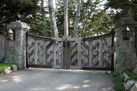 classic barn wooden driveway gates with chevron panels also cement fences and flooring as country style landscape designs