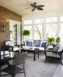 sunroom furniture designs. beautiful sunroom white cushions and blueandwhite pillows on black wicker furniture looks fresh clean traditional home photo werner straube designs