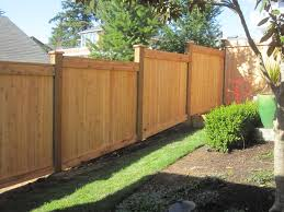 Stepped, full panel cedar wooden fence with grade.