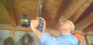 hook the two hooks together and use the drill to slowly drive the hook into the ceiling