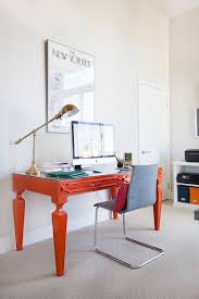 view in gallery bright orange desk brings color to the home office design homepolish bright home office design