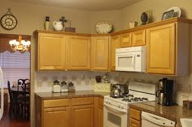 image of decorate tops of kitchen cabinets design