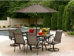 patio set with brown patio umbrella and 6 person patio chairs