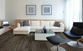 Wood flooring ideas for living room Fireplace Livingroomvinylflooringinspiration The Flooring Gallery Shop Vinyl Flooring Vinyl Plank Vinyl Tile At Carpet One