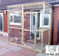cat enclosures attached to houses and buildings