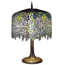 serena d italia tiffany wisteria 27 in bronze table lamp with tree trunk base