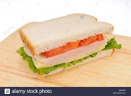 Half Of A Turkey And Cheese Sandwich On White Bread With Lettuce And