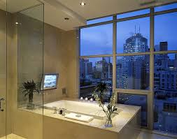tv in bathroom. inspiration for a contemporary beige tile bathroom remodel in toronto tv f