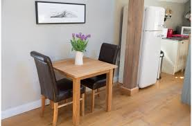 cool small dining room with oak lacqur dining table and dark brown leather upholstered dining chair