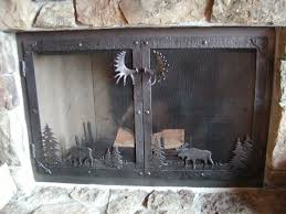 image of rustic fireplace screens with doors