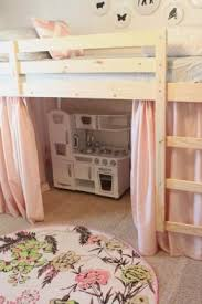 Simple & cheap low Ikea bunk beds turned into a loft bed with play space  below