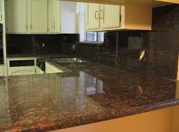 dark brown granite countertops with backsplash
