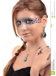 in black dress with earring and necklace with turquoise topaz gemstone with extreme make up with pearls on a white background