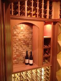 small wine closet with mahogany wine cellar racks and led lighting