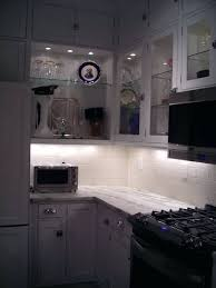 picture of glass front kitchen cabinets with decorative puck lights inside led display cabinet lighting battery