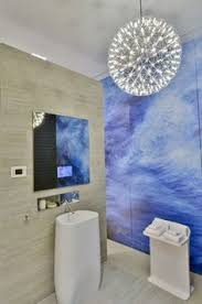 fascinating apartment design in natural concept wonderful bathroom area with blue wall unique rounded l clear mirror white sink and g