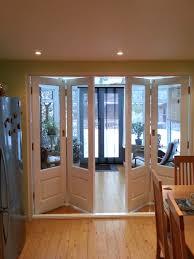 folding timber bi fold door painted white