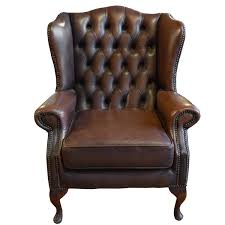 tufted leather wing chair