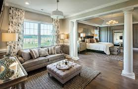 Master Bedroom With Sand Color Paint Sitting Area And Hardwood Floors