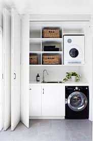 Concertina doors in the hallway conceal a small but perfectly formed laundry.  **Washing