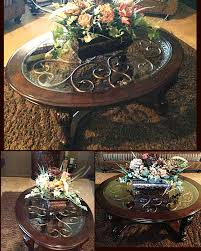 Ashley furniture Coffee table with artificial flower arrangement