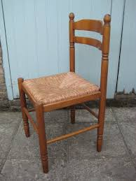 lovely pair of vine solid oak wood kitchen dining chairs with rush seats very good condition