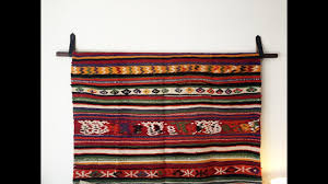 how to hang a rug hang a tapestry diy wall hanging diy with caitlin