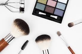 flat image of makeup and makeup brushes