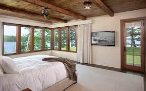 bedroom decor ceiling fan. horizontalrunning wooden panelling is painted a light cream to offset the dark wood floors bedroom decor ceiling fan