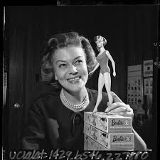 Barbie's first clothing designer Charlotte Johnson posing with 1965 Barbie  doll model — Calisphere