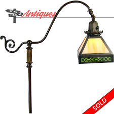 handel electric floor lamp with bronze base and green slag glass shade in arts crafts