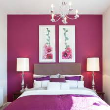 hot pink bedroom paint with crystal chandelier and two table lights
