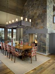 2 sided fireplace dining room contemporary with area rug high ceilings ceiling dining room lights photo 2