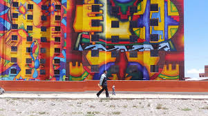 bolivia s most famous aymara artist decorated new social housing project with 12 story murals on most famous wall artist with bolivia s most famous aymara artist decorated new social housing