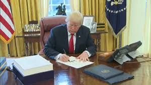 Image result for trump signing tax reform bill