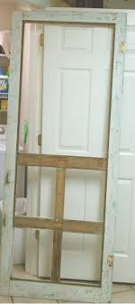 She purchased decorative trim, and a new screen from the hardward store,  then applied it to the pantry door.