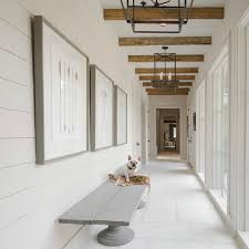 Farmhouse entry and hallway. Perfection in white and rustic beams ...