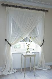 Overlapping sheer panels, conservatory and main bedroom window treatments