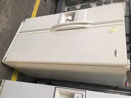 whirlpool side by side refrigerator white. off white side by whirlpool refrigerator good working condition -