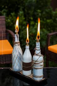 lighting tiki torches. Beer Bottle Tiki Torches On Coffee Table. Lighting