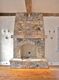 interior varnished log fireplace mantel design with stone fireplace and wood wall for rustic interior