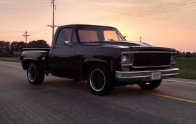 1975 Chevy C10 Stepside with Black Ridler 695 Wheels