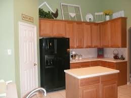 my client s cur kitchen with oak cabinets and green