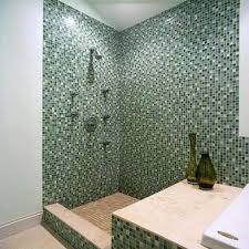 custom shower installation with glass walls and stone floors tops