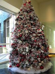Red and white themed Christmas tree. Adorn your Christmas tree in red and  white ornaments ...