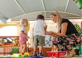Nursery Teacher Yalla Abu Dhabi Teddy Bear Nursery Teacher With Students Family